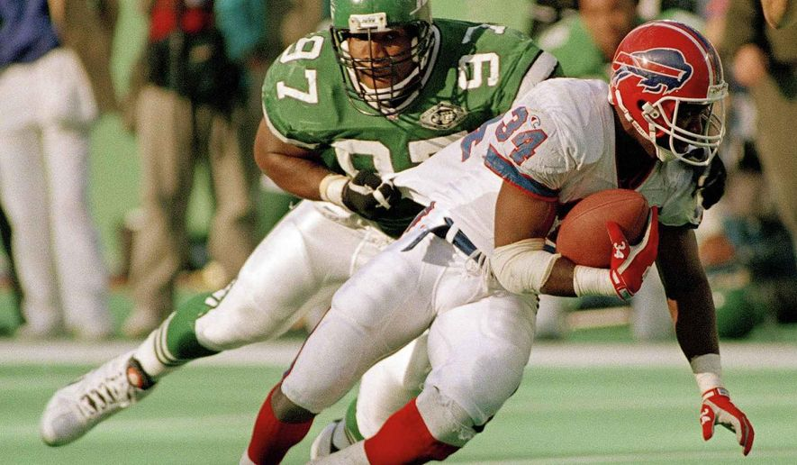 FILE - In this Oct. 24, 1993, file photo, New York Jets defensive lineman Marvin Washington (97) tackles Buffalo Bills' Thurman Thomas (34) in the third quarter of a football game at Giants Stadium in East Rutherford, N.J. As attitudes toward marijuana soften, and science slowly teases out marijuana's possible benefits for concussions and other injuries, the NFL is reaching a critical point in navigating its tenuous relationship with what is being recognized, more and more, as the analgesic of choice for many of its players. ``It's not, let's go smoke a joint,'' retired NFL defensive lineman Marvin Washington said. ``It's, what if you could take something that helps you heal faster from a concussion, that prevents your equilibrium from being off for two weeks and your eyesight for being off for four weeks?'' (AP Photo/Bill Kostroun, File)