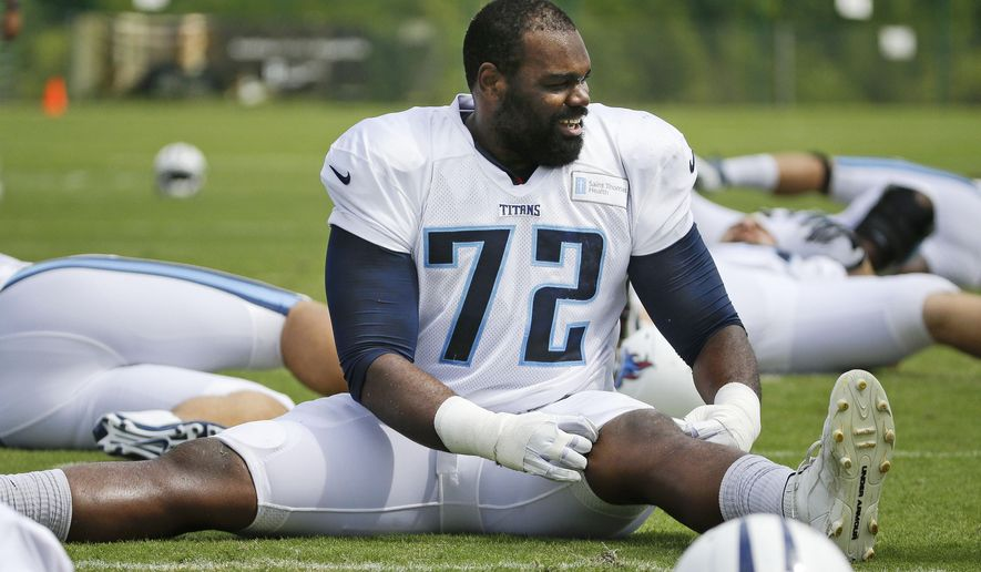 FILE - In this Aug. 1, 2014, file photo, Tennessee Titans tackle Michael Oher (72) warms up during NFL football training camp in Nashville, Tenn. The last time Oher played in New Orleans, he was a starting tackle for the Super Bowl champion Ravens. He returns less than two years later on Friday night, Aug. 15, 2014, for a preseason game with the Titans, trying to prove he's remains worthy of a starting job in the NFL. (AP Photo/Mark Humphrey, File)