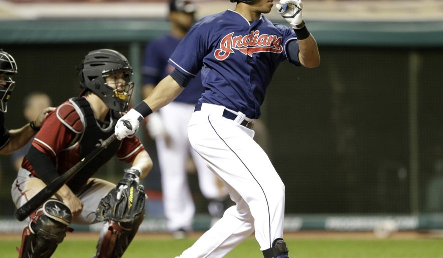 Cleveland Indians' Michael Brantley hits a single in the eighth inning against Arizona Diamondbacks relief pitcher Eury De La Rosa in the second baseball game of a doubleheader, Wednesday, Aug. 13, 2014, in Cleveland. Diamondbacks catcher Tuffy Gosewisch watches (AP Photo/Tony Dejak)