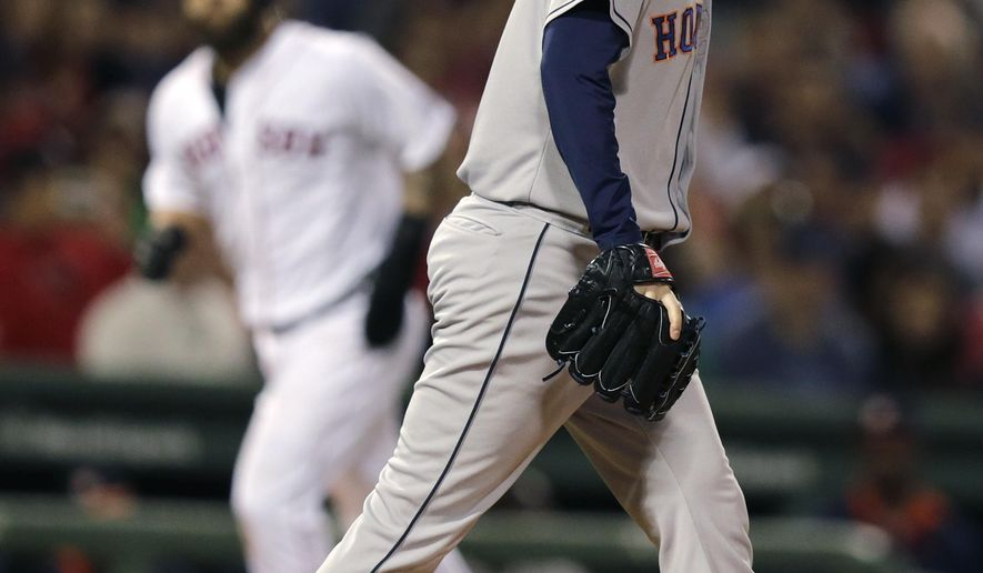 Houston Astros pitcher Darin Downswalks back to the mound after walking Boston Red Sox batter Jackie Bradley Jr. with bases loaded, scoring Mike Napoli, during the sixth inning of a baseball game at Fenway Park in Boston, Thursday, Aug. 14, 2014. (AP Photo/Charles Krupa)