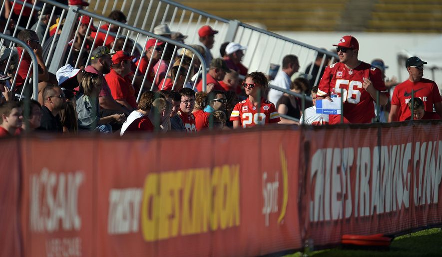 Kansas City Chiefs fans arrive for practice Wednesday morning Aug. 13, 2014,  on the Missouri Western State University campus in St. Joseph. Mo. (AP Photo/St. Joseph News-Press, Todd Weddle)