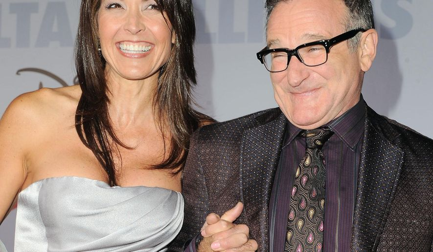 """FILE - This Nov. 9, 2009 file photo shows actor Robin Williams, right, and  his wife Susan Schneider at the premiere of """"Old Dogs"""" in Los Angeles. Williams, whose free-form comedy and adept impressions dazzled audiences for decades, died Monday, Aug. 11, 2014, in an apparent suicide. Williams was 63. (AP Photo/Katy Winn, FIle)"""