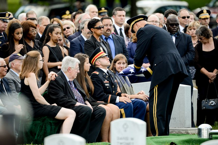 The family of Army Maj. Gen. Harold J. Greene, from left,  daughter-in-law Kasandra Greene, father Harold Greene, daughter Amelia Greene, son Army 1st Lt. Matthew Greene and his wife, Dr. Susan Myers, during his funeral service at Section 60 at Arlington National Cemetery, Arlington, Va., Thursday, August 14, 2014. Greene was killed in Afghanistan while at the national military academy in Kabul. He was the highest-ranking U.S. Army officer killed in combat since the Vietnam War. (Andrew Harnik/The Washington Times)