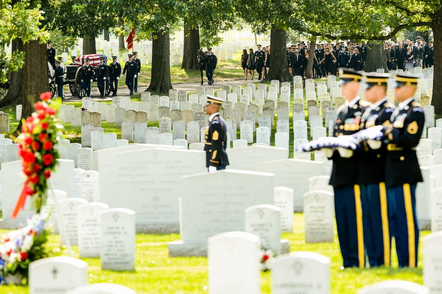 Members of the Old Guard brings the casket of U.S. Army Maj. Gen. Harold J. Greene by caisson, left, to Section 60 at Arlington National Cemetery for his funeral service, Arlington, Va., Thursday, August 14, 2014. Greene was killed in Afghanistan while at the national military academy in Kabul. He was the highest-ranking U.S. Army officer killed in combat since the Vietnam War. (Andrew Harnik/The Washington Times)