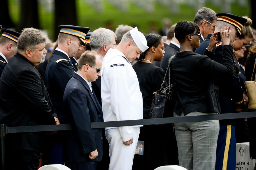 A service member bows his head during the funeral service for U.S. Army Maj. Gen. Harold J. Greene in Section 60 at Arlington NationalCemetery, Arlington, Va., Thursday, August 14, 2014. Greene was killed in Afghanistan while at the national military academy in Kabul. He was the highest-ranking U.S. Army officer killed in combat since the Vietnam War. (Andrew Harnik/The Washington Times)