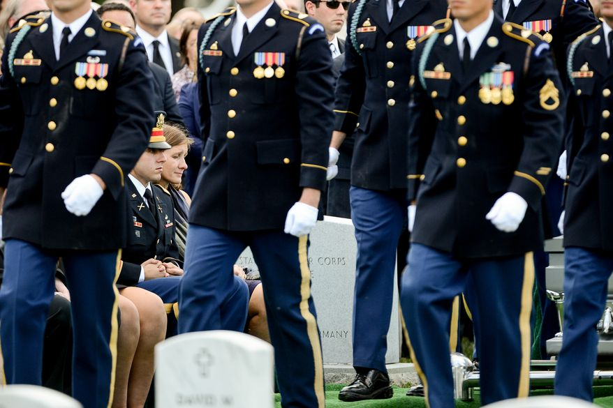 The family of Army Maj. Gen. Harold J. Greene, son Army 1st Lt. Matthew Greene, left, and his wife, Dr. Susan Myers, right, during his funeral service at Section 60 at Arlington National Cemetery, Arlington, Va., Thursday, August 14, 2014. Greene was killed in Afghanistan while at the national military academy in Kabul. He was the highest-ranking U.S. Army officer killed in combat since the Vietnam War. (Andrew Harnik/The Washington Times)