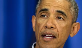 President Barack Obama speaks about the situations in Iraq and in Ferguson, Mo., Thursday, Aug. 14, 2014, in Edgartown, Mass., during his family vacation on the island of Martha's Vineyard. (AP Photo/Jacquelyn Martin)