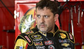 "In this Friday, Aug. 8, 2014 photograph, Tony Stewart stands in the garage area after a practice session for Sunday's NASCAR Sprint Cup Series auto race at Watkins Glen International, in Watkins Glen N.Y.  Stewart struck and killed Kevin Ward Jr., 20, a sprint car driver who had climbed from his car and was on the track trying to confront Stewart during a race at Canandaigua Motorsports Park in upstate New York on Saturday night. Ontario County Sheriff Philip Povero said his department's investigation is not criminal and that Stewart was ""fully cooperative"" and appeared ""very upset"" over what had happened. (AP Photo/Derik Hamilton)"
