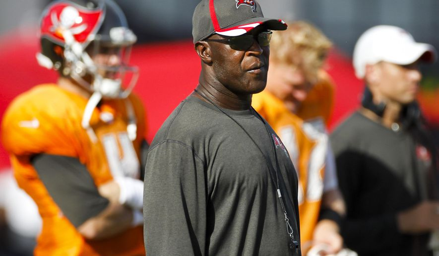 Tampa Bay Buccaneers head coach Lovie Smith watches during NFL training camp, Tuesday, Aug. 12, 2014 in Tampa, Fla.   (AP Photo/The Tampa Bay Times, Will Vragovic) TAMPA OUT; CITRUS COUNTY OUT; PORT CHARLOTTE OUT; BROOKSVILLE HERNANDO TODAY OUT