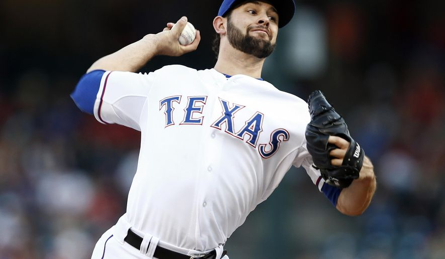 Texas Rangers starting pitcher Nick Martinez throws to the Los Angeles Angels during the first inning of a baseball game, Friday, Aug. 15, 2014, in Arlington, Texas. (AP Photo/Jim Cowsert)