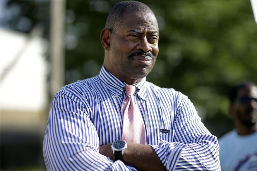 In this photo taken on Monday, Aug. 4, 2014, former Philadelphia Eagles NFL football player Garry Cobb, a Republican Congressional candidate in New Jersey's 1st Congressional District,  listens to a question at a gathering in Cherry Hill, N.J. (AP Photo/Mel Evans)