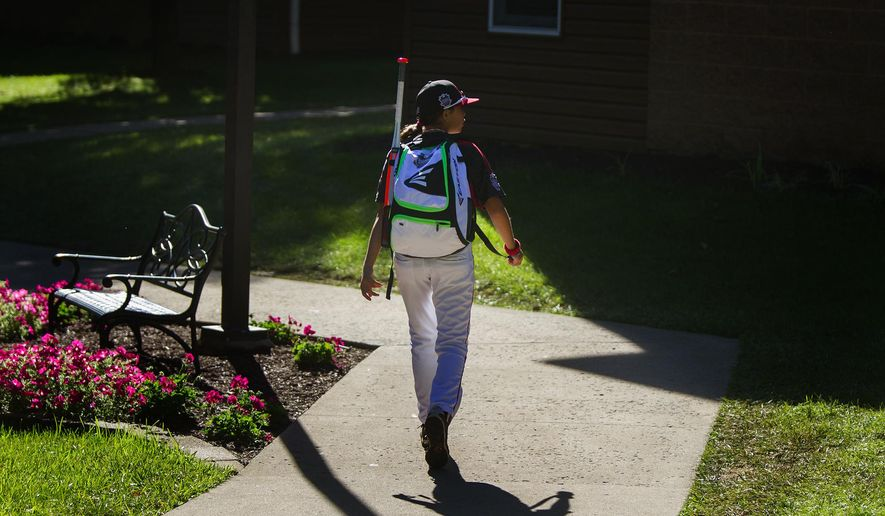 Canada's Emma March walks through the International Grove, the village where the players live during the Little League World Series tournament on Aug. 15, 2014, in Williamsport, Pa. (AP Photo/PennLive.com, Sean Simmers)
