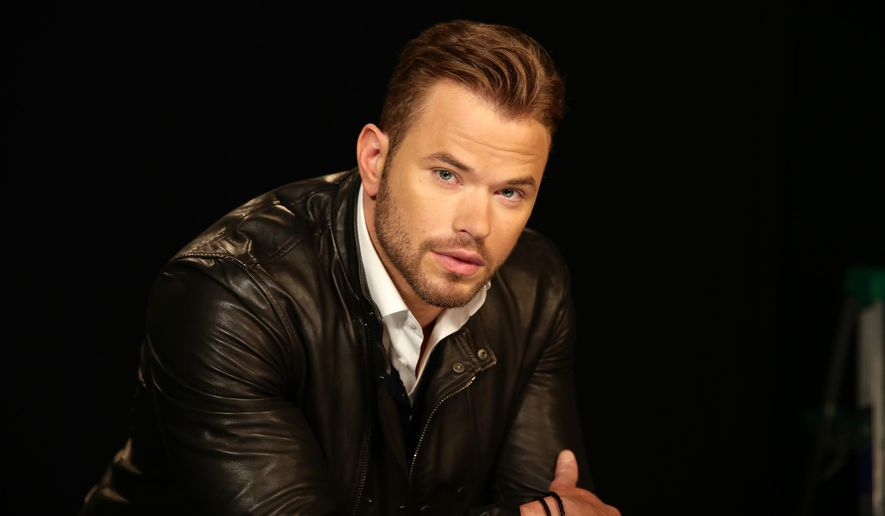 "Actor Kellan Lutz poses for a portrait in New York on Thursday, Aug. 14, 2014. Lutz stars in the action film, ""Expendables 3,"" opening Friday. (AP Photo/John Carucci)"