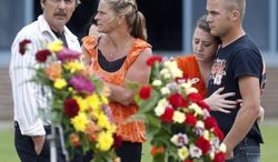 Mourners gather after a funeral for race car driver Kevin Ward Jr. outside South Lewis Central School, Thursday, Aug. 14, 2014, in Turin, N.Y. Ward died after being struck by NASCAR driver Tony Stewart's car during a race last weekend at a dirt track in western New York. (AP Photo/Mike Groll)
