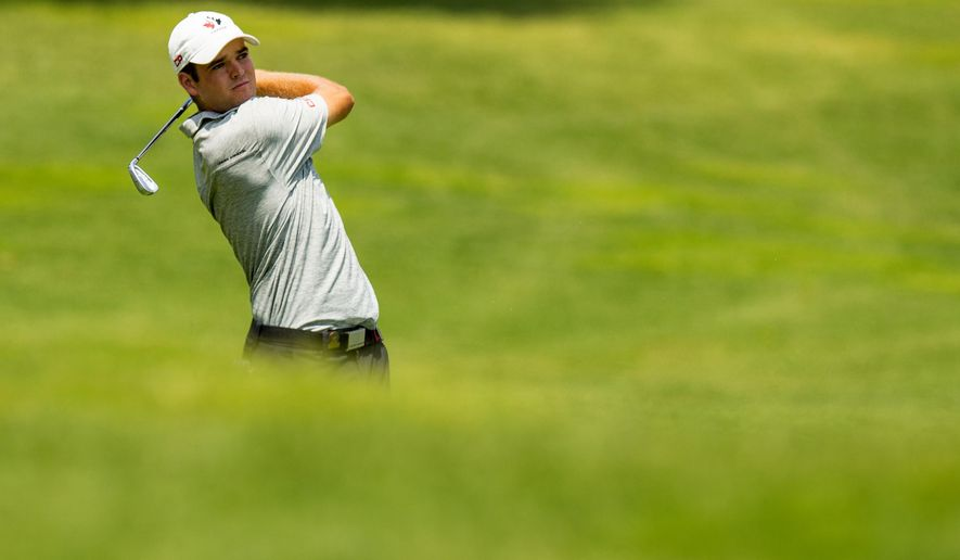 Corey Conners, of Canada, plays his second shot on the eighth hole during the quarterfinal round of match play at the U.S. Amateur Championship golf tournament at Atlanta Athletic Club in Johns Creek, Ga., Friday, Aug. 15, 2014.  (AP Photo/USGA, John Mummert)