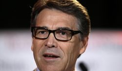 FILE - In this Friday, Aug. 8, 2014, file photo, Texas Gov. Rick Perry delivers a speech to nearly 300 in attendance at the 2014 RedState Gathering, in Fort Worth, Texas. Perry was indicted on Friday, Aug. 15, 2014, for abuse of power after carrying out a threat to veto funding for state public corruption prosecutors. (AP Photo/Tony Gutierrez, File)