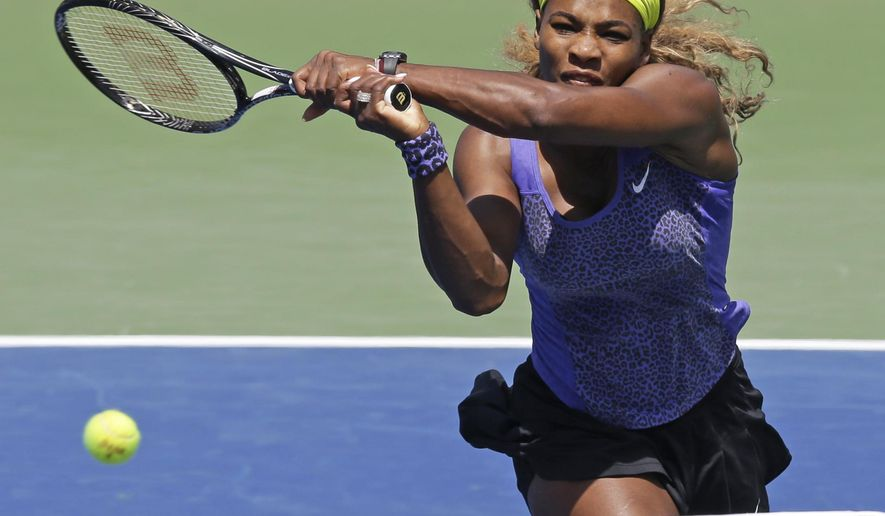 Serena Williams volleys against Jelena Jankovic, from Serbia, during a match at the Western & Southern Open tennis tournament, Friday, Aug. 15, 2014, in Mason, Ohio. (AP Photo/Al Behrman)