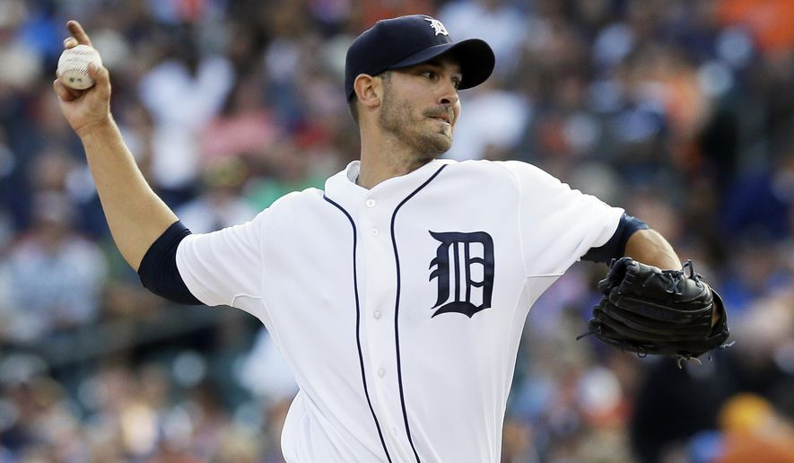 Detroit Tigers starting pitcher Rick Porcello throws during the first inning of a baseball game against the Seattle Mariners, Friday, Aug. 15, 2014, in Detroit. (AP Photo/Carlos Osorio)