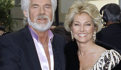 10. Country music icon Kenny Rogers divorced from his wife Marianne to the tune of $60 million. Country music singer Kenny Rogers arrives with his wife Marianne at the People's Choice Awards in Hollywood, March 10, 1990. (AP Photo/Doug Sheridan)