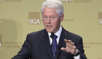 Former President Bill Clinton speaks at the Southern Governors Association meeting in Little Rock, Ark., Friday, Aug. 15, 2014. (AP Photo/Danny Johnston)