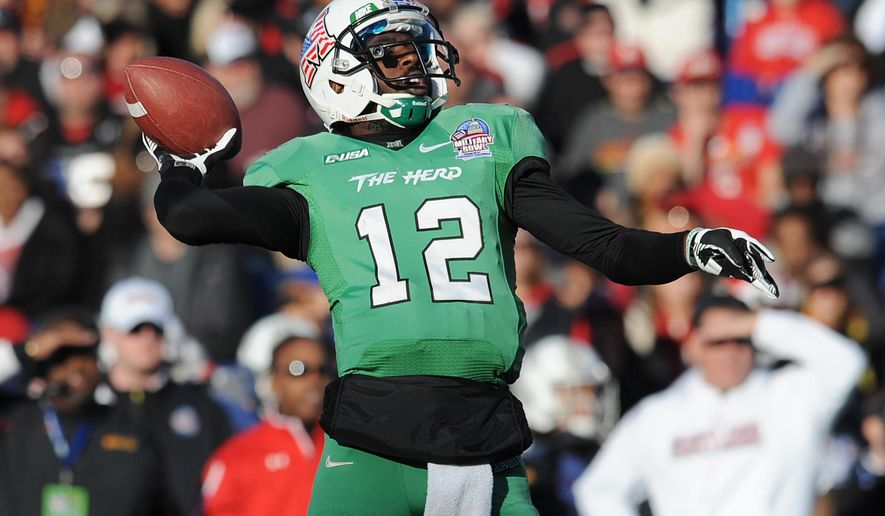 FILE - In this Dec. 27, 2013, file photo, Marshall's quarterback Rakeem Cato throws in the first half of the Military Bowl NCAA college football game against Maryland in Annapolis, Md. This year, Marshall, which joined Conference USA in 2005, is the preseason favorite. (AP Photo/Gail Burton, File)