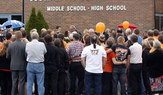 The casket of race car driver Kevin Ward Jr., is carried through mourners outside South Lewis Central School after a funeral on Thursday, Aug. 14, 2014, in Turin, N.Y. Ward died after being struck by NASCAR driver Tony Stewart's car during a race last weekend at a dirt track in western New York. (AP Photo/Mike Groll)