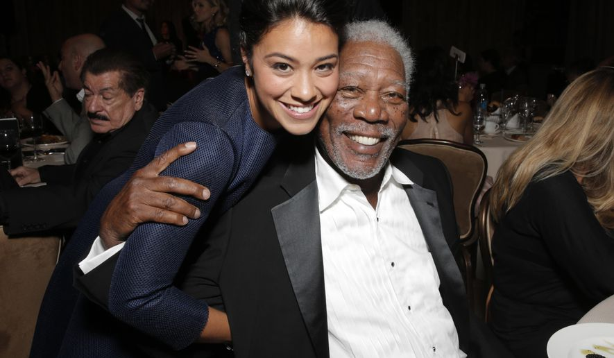 Gina Rodriguez, left, and Morgan Freeman attend the Hollywood Foreign Press Association's Grants Banquet at the Beverly Hilton hotel on Thursday, Aug. 14, 2014, in Beverly Hills, Calif.(Photo by Todd Williamson/Invision/AP)
