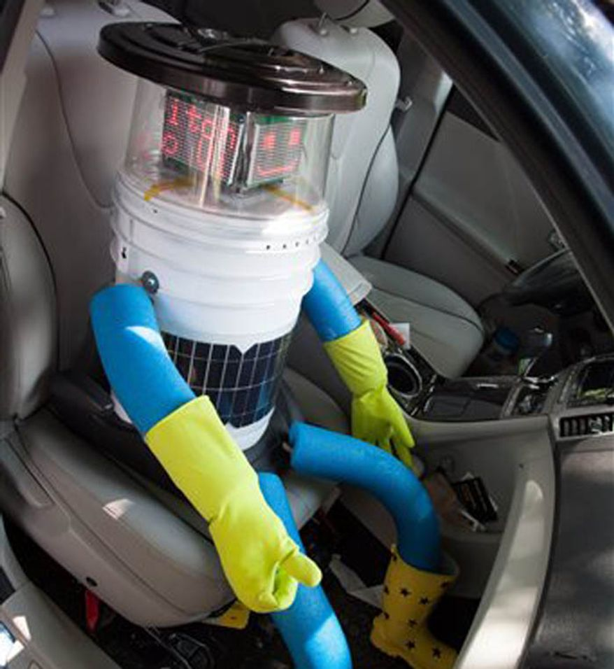 HitchBOT hitchhikes with strangers to travel from Canada's east to west coast. This Aug. 14, 2014 photo shows the robot nearing the end of its journey. Its final destination is Victoria, British Columbia, Canada which its creators expect it to reach by Aug. 17, 2014. (Associated Press/Ryerson University)