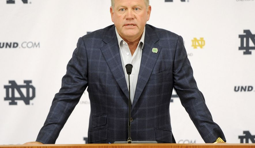 """FILE - In this Aug. 1, 2014, file photo, Notre Dame football coach Brian Kelly talks to the media at the beginning of fall practice in South Bend, Ind. Notre Dame says it is investigating """"suspected academic dishonesty"""" involving several students, including four members of the football team. The school released a statement Friday, Aug. 15 saying it has notified the NCAA and that because of potential NCAA violations the four players are being held out of practice and completion until the conclusion of the investigation and the university honor code process. (AP Photo/Joe Raymond, File)"""