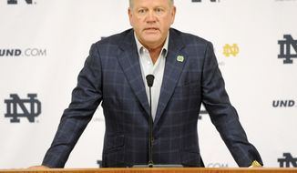 "FILE - In this Aug. 1, 2014, file photo, Notre Dame football coach Brian Kelly talks to the media at the beginning of fall practice in South Bend, Ind. Notre Dame says it is investigating ""suspected academic dishonesty"" involving several students, including four members of the football team. The school released a statement Friday, Aug. 15 saying it has notified the NCAA and that because of potential NCAA violations the four players are being held out of practice and completion until the conclusion of the investigation and the university honor code process. (AP Photo/Joe Raymond, File)"