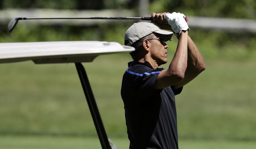 President Obama is poised to notch the lowest deficit of his six-year tenure at just more than a half-trillion dollars, but more financial pain lies ahead. (AP Photo/Steven Senne)