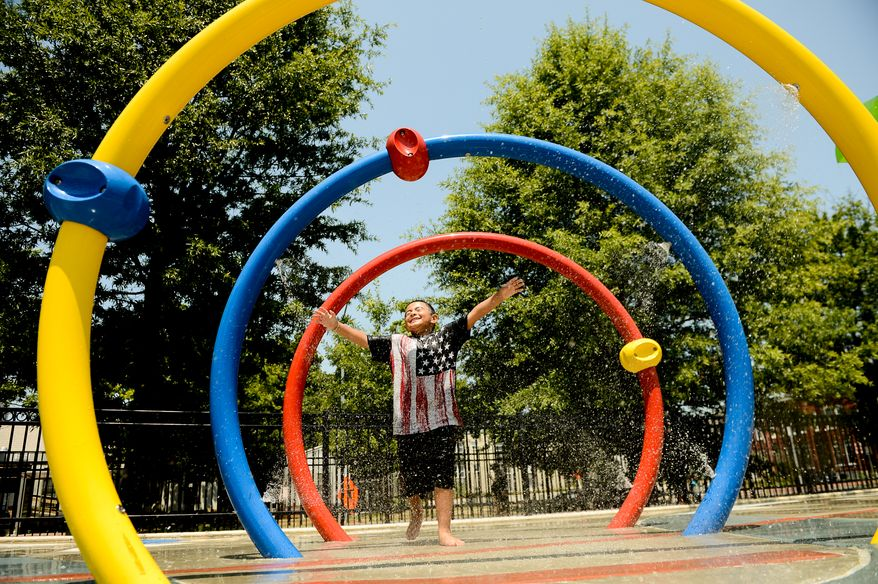 Michael Gonzales, 5, of Washington, D.C. cools off at the Kennedy Recreation Center in Shaw, Washington, D.C., Monday, July 7, 2014. (Andrew Harnik/The Washington Times)