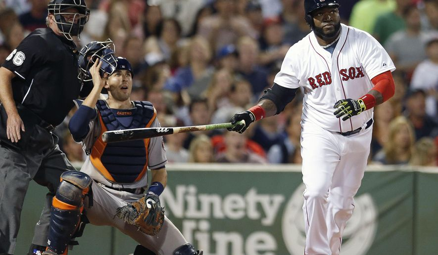 Boston Red Sox's David Ortiz, right, watches his two-run home run in front of Houston Astros' Jason Castro during the fifth inning of a baseball game in Boston, Saturday, Aug. 16, 2014. (AP Photo/Michael Dwyer)
