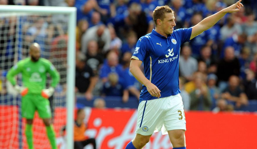 Leicester's Chris Wood celebrates after scoring the equalizer against Everton during the English Premier League soccer match between Leicester City and Everton at King Power Stadium, in Leicester, England, Saturday, Aug 16, 2014.  (AP Photo/Rui Vieira)