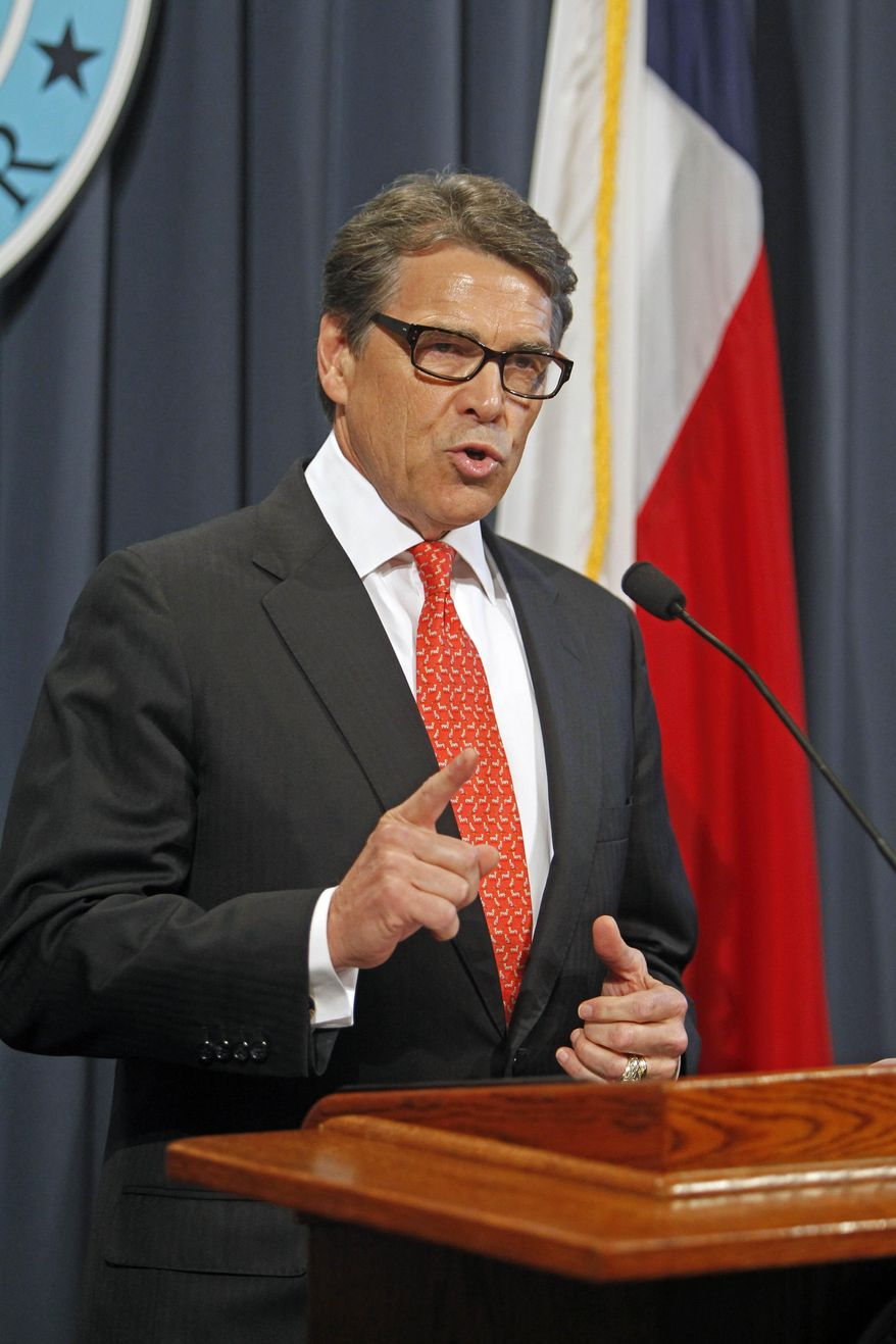 Gov. Rick Perry makes a statement in Austin, Texas on Saturday, Aug. 16, 2014 concerning the indictment on charges of coercion of a public servant and abuse of his official capacity. Perry is the first Texas governor since 1917 to be indicted. (AP Photo/Michael Thomas)