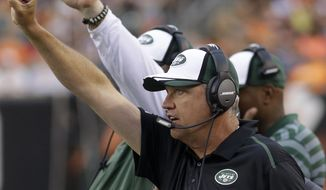 New York Jets head coach Rex Ryan calls a play from the sidelines in the first half of an NFL preseason football game against the Cincinnati Bengals, Saturday, Aug. 16, 2014, in Cincinnati. (AP Photo/Tom Uhlman)