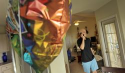 Todd Blake on the phone at the apartment he shares with his wife Maja Blake and their new puppy Louie in Ponte Vedra Beach, Fla.  Blake is a recent graduate of the University of Florida who graduated with a 4.0 GPA and is battling Stage IV Hodgkin's Lymphoma.  (AP Photo/The Florida Times-Union/Bob Self)