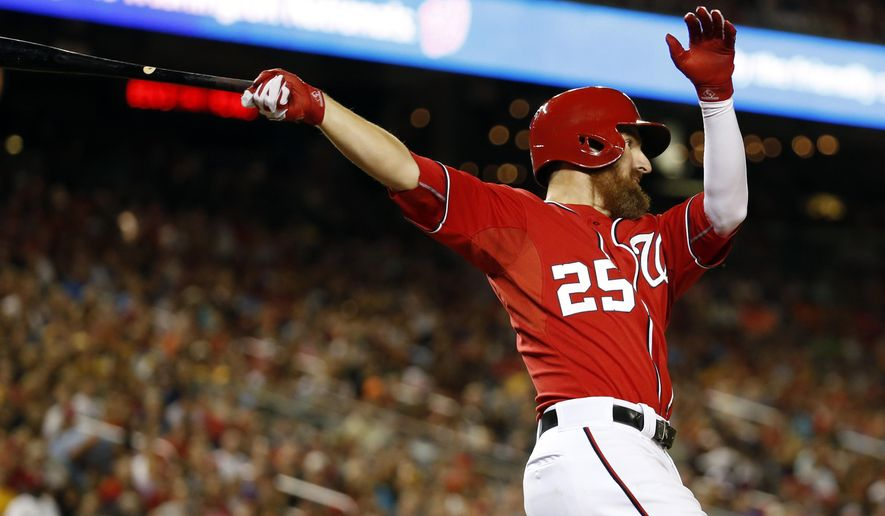 Washington Nationals' Adam LaRoche follows through on his two-run homer during the eighth inning of a baseball game against the Pittsburgh Pirates at Nationals Park, Saturday, Aug. 16, 2014, in Washington. The Nationals won 4-3. (AP Photo/Alex Brandon)