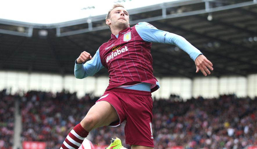 Aston Villa's Andreas Weimann celebrates scoring his side's first goal of the game during the English Premier League soccer match against Stoke City at The Britannia Stadium, Stoke, England, Saturday, Aug. 16, 2014. (AP Photo/Lynne Cameron, PA Wire)    UNITED KINGDOM OUT    -   NO SALES   -    NO ARCHIVES