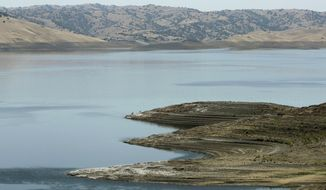 This June 8, 2014, photo shows low water levels at the San Luis Reservoir near Gustine, Calif. California Gov. Jerry Brown and state lawmakers used the backdrop of California's most severe drought in nearly four decades to put the $7.5 billion water plan on the ballot earlier this week. Despite its size, the measure will not solve the problems created by the drought nor is it expected to prevent rationing during future ones. (AP Photo/Rich Pedroncelli)