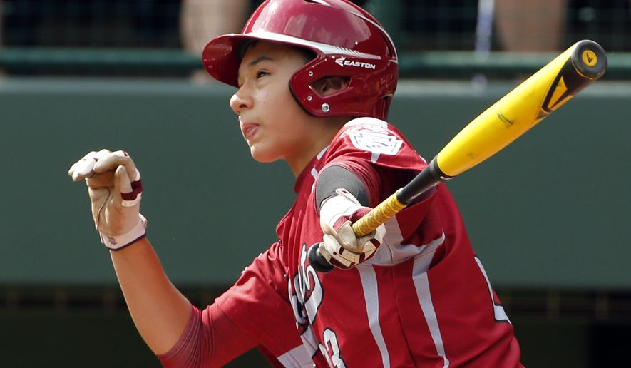 Lynnwood's Colton Walsh watches his two-run home run off Rapid City pitcher Daniel Vigoren in the fourth inning of an elimination baseball game at the Little League World Series tournament in South Williamsport, Pa., Saturday, Aug. 16, 2014. (AP Photo/Gene J. Puskar)