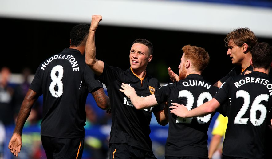 Hull City's James Chester, second left, celebrates scoring the opening goal against Queens Park Rangers during their English Premier League soccer match at Loftus Road, London, England, Saturday, Aug. 16, 2014. (AP Photo/John Walton, PA Wire)  UNITED KINGDOM OUT    -   NO SALES   -    NO ARCHIVES