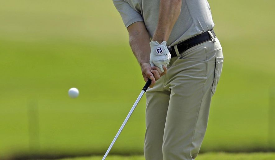 Heath Slocum chips to the 18th green during the second round of the Wyndham Championship golf tournament in Greensboro, N.C., Friday, Aug. 15, 2014. (AP Photo/Chuck Burton)