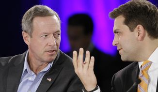 Maryland Gov. Martin O'Malley, left, talks with Arkansas state Sen. Jonathan Dismang during a meeting dealing with healthcare at the Southern Governors' Association in Little Rock, Ark., Saturday, Aug. 16, 2014. (AP Photo/Danny Johnston)
