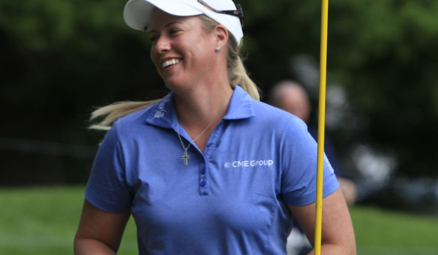 Brittany Lincicome smiles after her eagle on 14 during the second round LPGA Championship golf tournament, Friday, Aug. 15, 2014, in Pittsford, N.Y. (AP Photo/Democrat & Chronicle, Annette Lein)