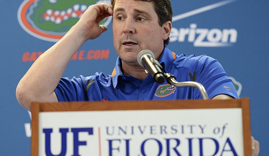 FILE - In this Aug, 3, 2014, file photo, Florida head football coach Will Muschamp fields questions from the media during an NCAA college football Media Day, in Gainesville, Fla. Coaches often say they are always on the hot seat. That might be true, but some seats are hotter than others. A few coaches in high-profile positions heading into 2014 very much in need of winning records and quality victories. (AP Photo/Phil Sandlin, File)