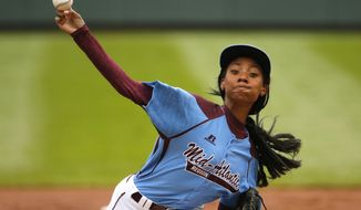 Pennsylvania's Mo'ne Davis delivers in the first inning against Tennessee during a baseball game in United States pool play at the Little League World Series tournament in South Williamsport, Pa., Friday, Aug. 15, 2014. (AP Photo/Gene J. Puskar)