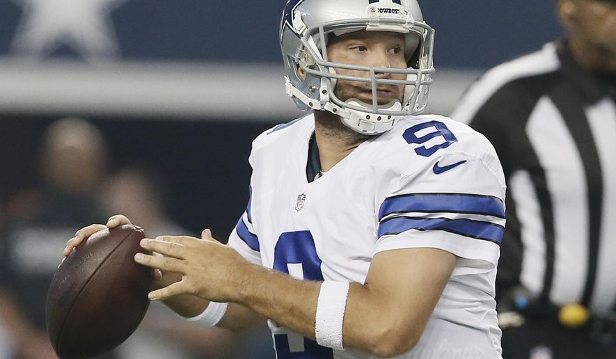 Dallas Cowboys quarterback Tony Romo (9) looks for a receiver during the first half of an NFL preseason football game against the Baltimore Ravens, Saturday, Aug. 16, 2014, in Arlington, Texas. (AP Photo/Brandon Wade)