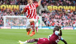 Aston Villa's Aly Cissokho, right, and Stoke City's Bojan battle for the ball during their English Premier League soccer match at The Britannia Stadium, Stoke, England, Saturday, Aug. 16, 2014. (AP Photo/Lynne Cameron, PA Wire)    UNITED KINGDOM OUT    -   NO SALES   -   NO ARCHIVES