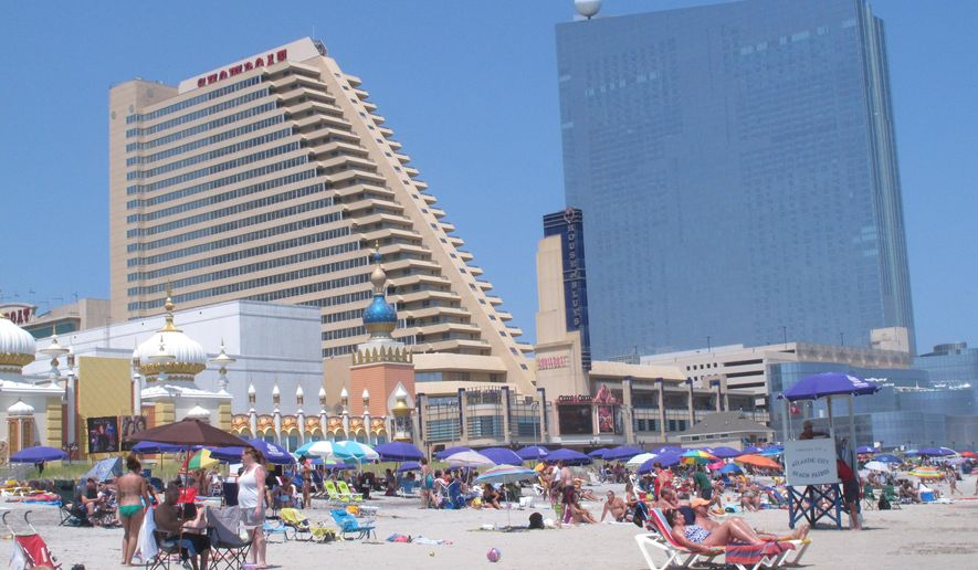 This July 23, 2014 photo shows the Showboat, left, and Revel, right, two Atlantic City N.J. casinos that are due to close by mid-September. Possible uses for former casino buildings include office space, non-gambling hotels or even student housing, according to analysts and businesspeople. (AP Photo/Wayne Parry)